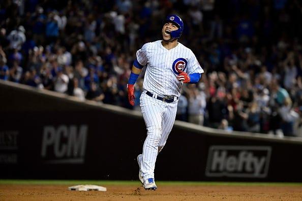 Willson Contreras celebrates hitting a home run.