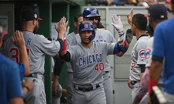 Cubs teammates congratulate Willson Contreras in the dugout.