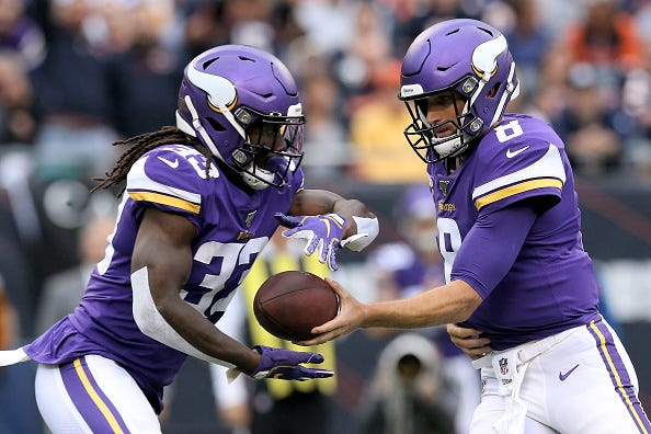 Dalvin Cook receives the handoff from Vikings QB Kirk Cousins.