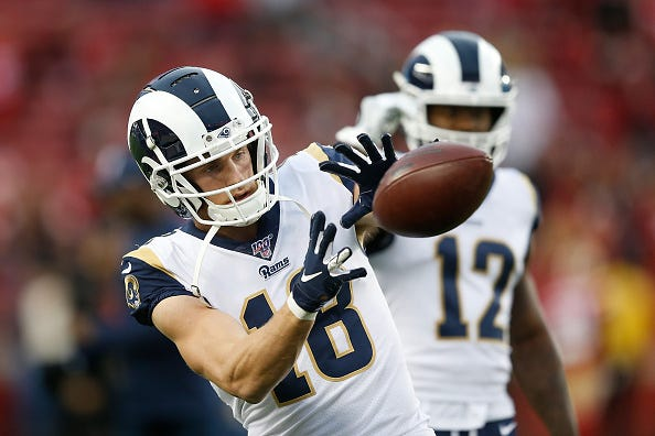 Cooper Kupp catches a pass while warming up for the Rams.