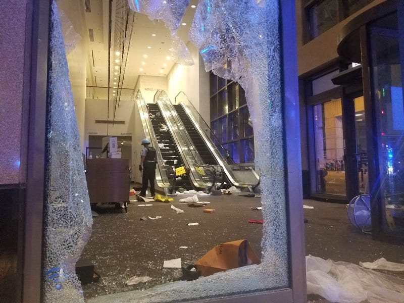 Cop In Store After Mag Mile Looting
