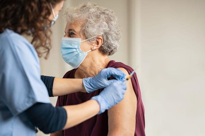 Elderly woman receiving her coronavirus vaccine