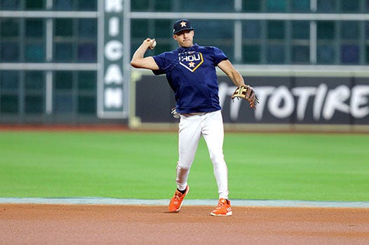 Carlos Correa warms up before a game.