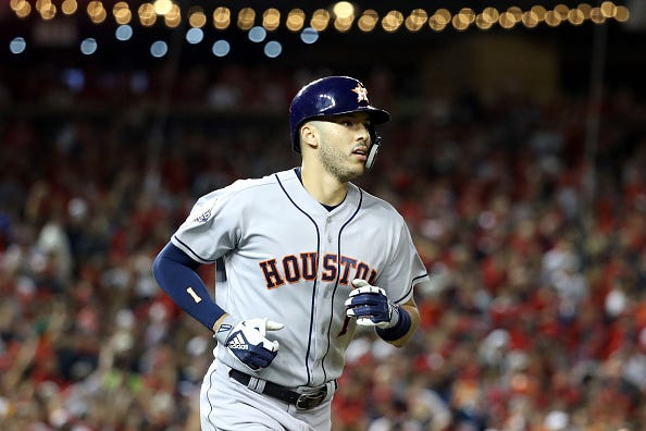 Carlos Correa looks on after hitting a home run in the World Series.