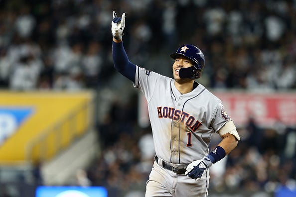 Carlos Correa celebrates a home run against the Yankees.