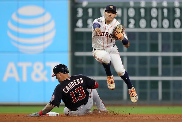 Carlos Correa evades Asdrubal Cabrera to turn two.