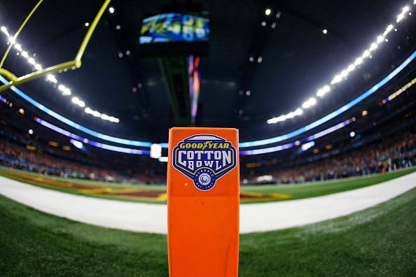The Cotton Bowl logo is placed on a pylon behind the end zone.