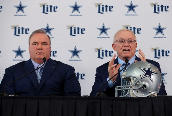 Cowboys head coach Mike McCarthy and owner Jerry Jones speak at a press conference.