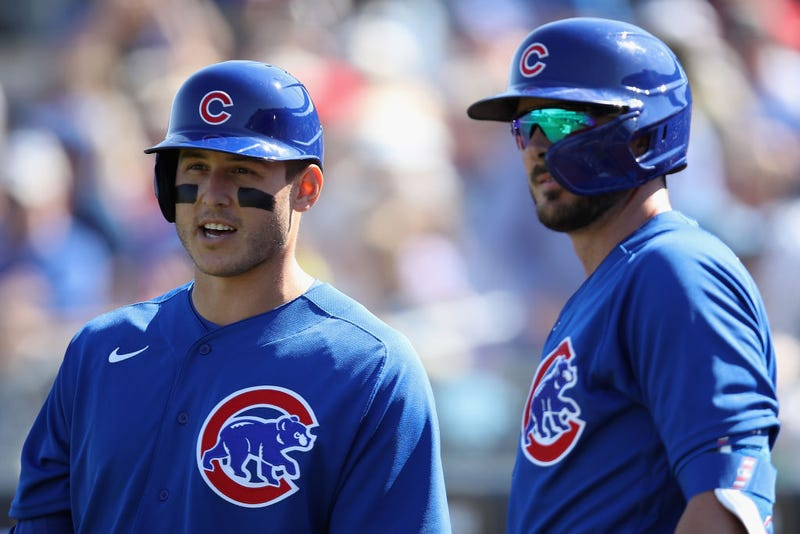 Anthony Rizzo and Kris Bryant chat during a game.