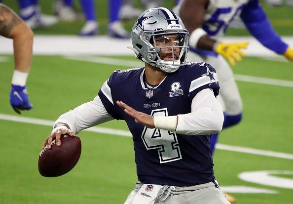 Dak Prescott drops back for a pass with the Cowboys.