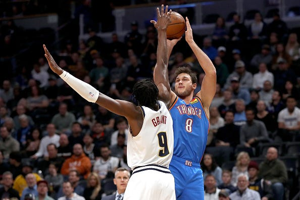 Danilo Gallinari shoots over a defender during a Thunder game.