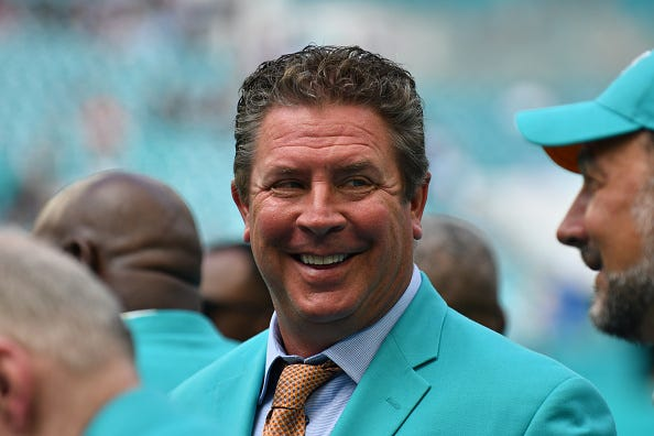Dan Marino chats on the sidelines prior to a Dolphins game in 2019.