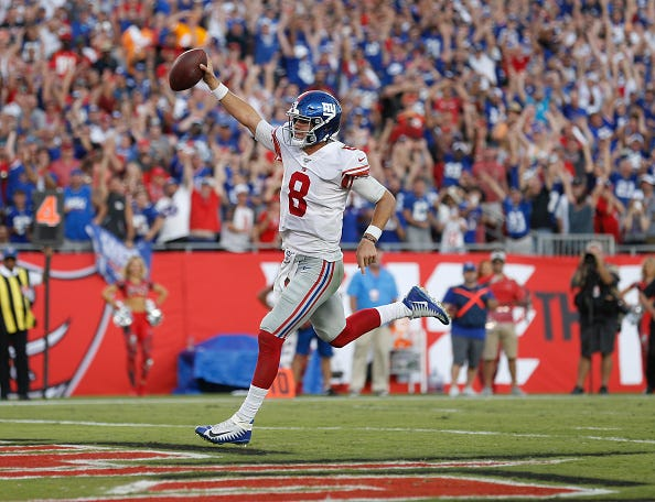 Giants QB Daniel Jones celebrates a rushing TD.