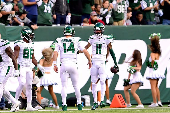 Sam Darnold celebrates with Robby Anderson after a Jets TD.
