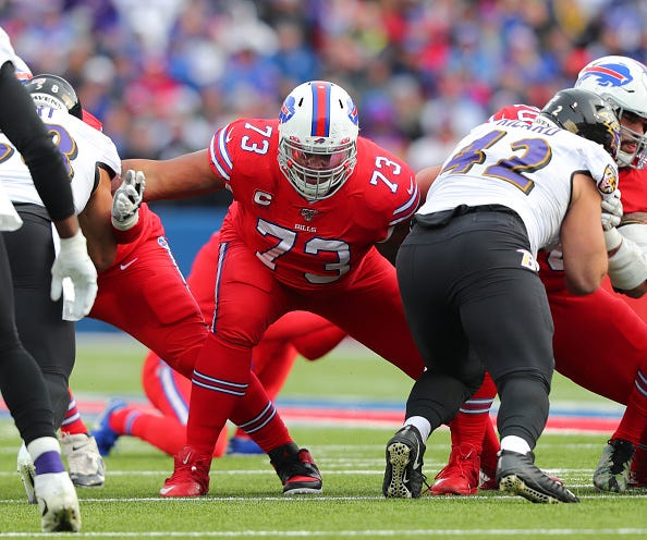Dion Dawkins blocks for the Bills in a game against the Ravens.