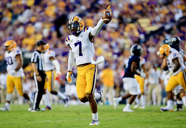 LSU S Grant Delpit celebrates an interception.