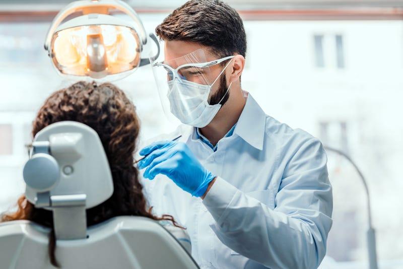Dentist treats patient