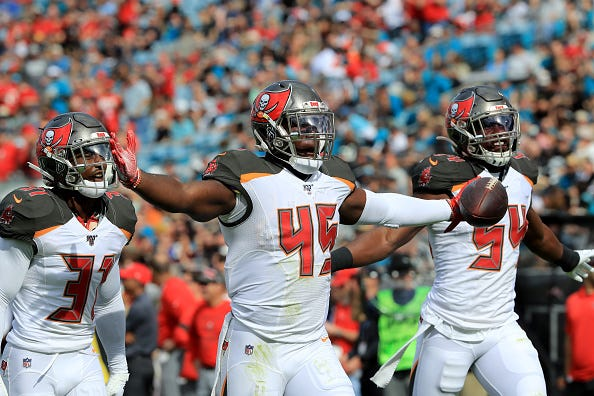 Devin White celebrates coming up with the ball for the Bucs.