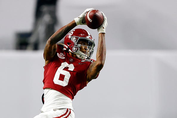 Devonta Smith makes a catch in a game for Alabama.