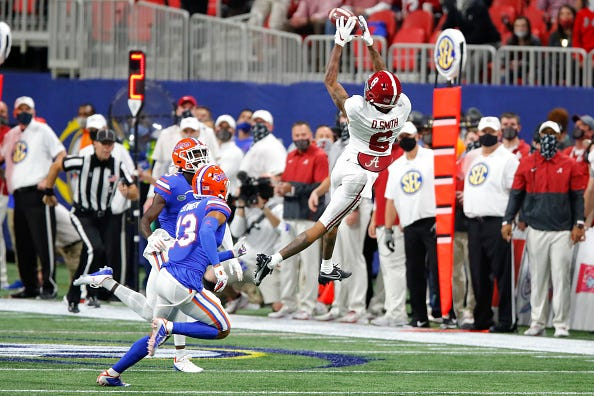 Devonta Smith elevates to make a catch for Alabama.