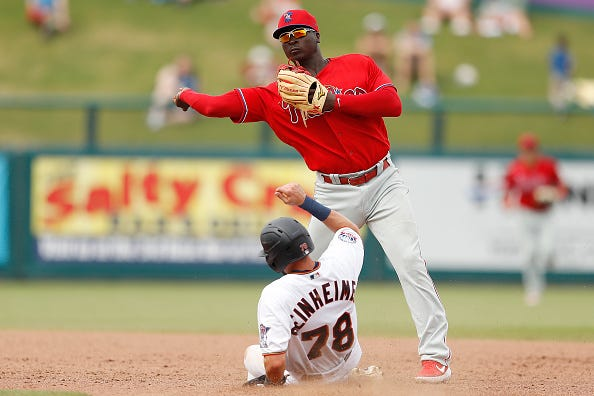 Didi Gregorius turns a double play in spring training.