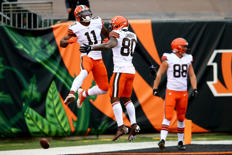 Cleveland Browns wide receiver Donovan Peoples-Jones, left, celebrates a go-ahead touchdown catch with Cleveland Browns wide receiver Jarvis Landry during the fourth quarter of a Week 7 NFL football game against the Cincinnati Bengals, Sunday, Oct. 25, 2020, at Paul Brown Stadium in Cincinnati. The Cleveland Browns won 37-34.