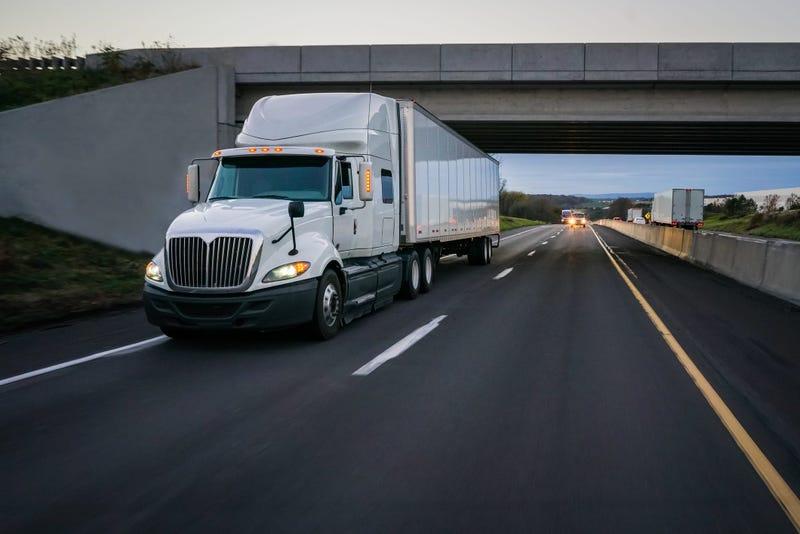 Semi truck under overpass