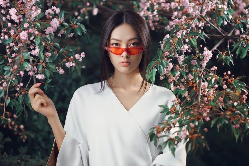 Asian woman fashion close-up portrait outdoors. Lady, fantasy.