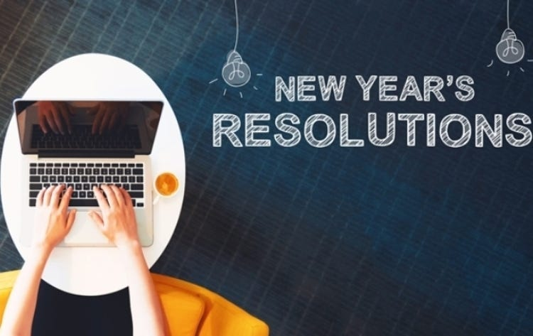 New Year`s Resolutions with person using a laptop
