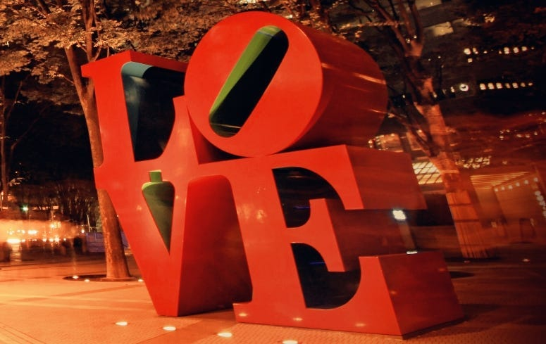 Autumn night photo shot of LOVE sculpture in the city of Shinjuku Tokyo Japan.