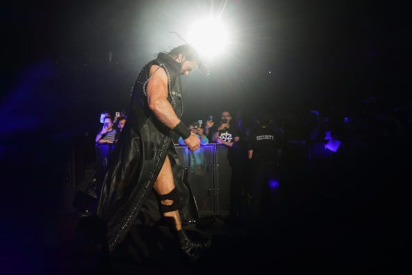 WWE star Drew McIntyre enters the ring in Singapore.