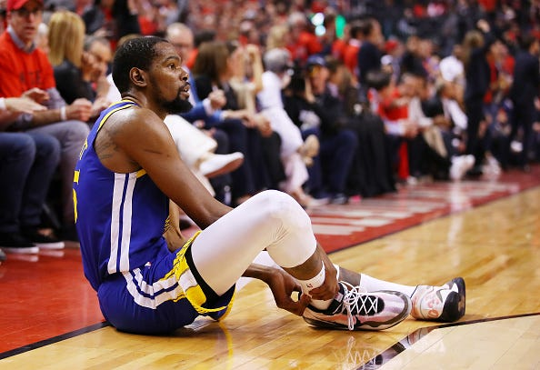 Kevin Durant grabs his ruptured Achilles tendon in the 2019 NBA Finals.