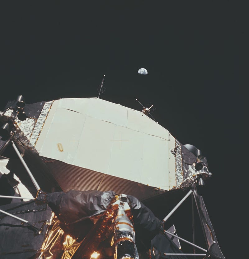 The Lunar Module or 'Eagle' on the Moon with the Earth visible behind it.