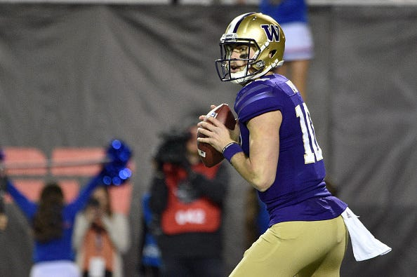Jacob Eason eyes his receivers down field with Washington.