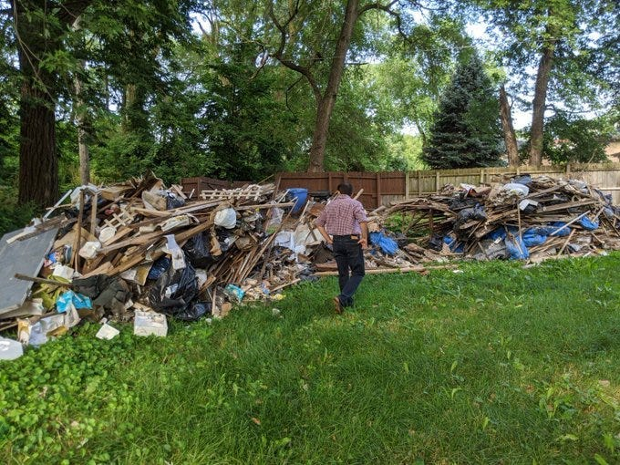 A Ring doorbell camera caught two men emptying the contents of a dump truck -much of it appearing to be construction debris -in a lot near 58th and Wood in the West Englewood neighborhoodovernight Monday into Tuesday.
