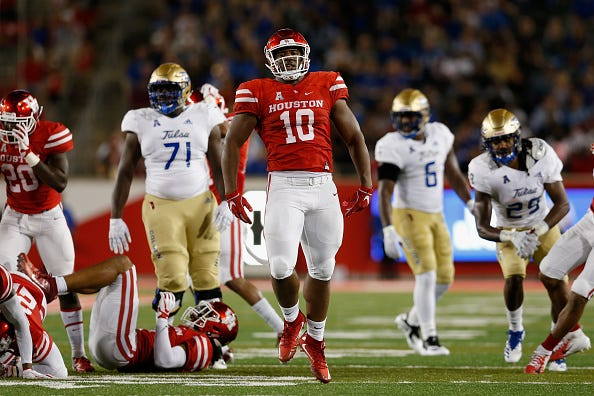 Ed Oliver celebrates a play at the University of Houston.