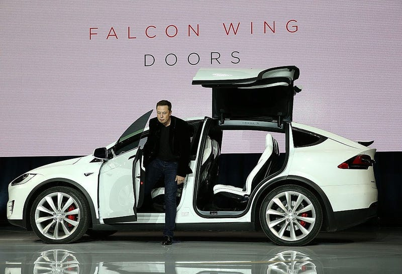 Tesla CEO Elon Musk demonstrates the falcon wing doors on the new Tesla Model X Crossover SUV.
