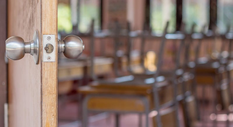 And open door shows an empty classroom