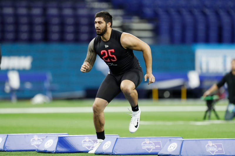 A.J. Epenesa shows off his lateral movement at the NFL Scouting Combine.