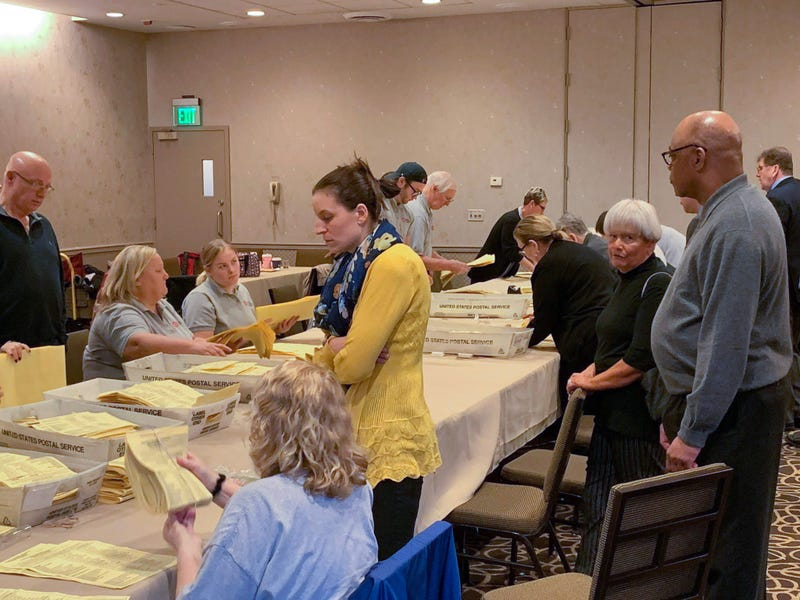 PFT president Jerry Jordan (at far right) watches ballots counted at the Doubletree Hotel in Center City.