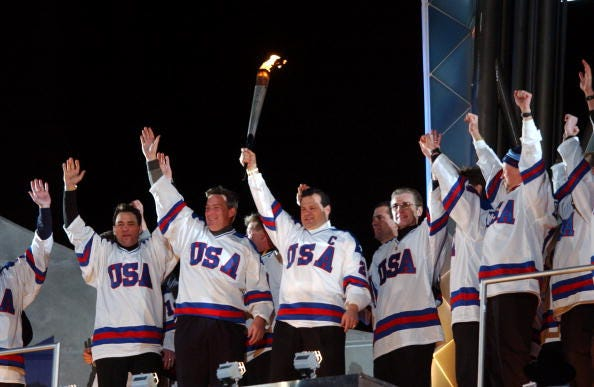 Mike Eruzione and the 1980 U.S. Hockey Team light the torch at the 2002 Winter Games.