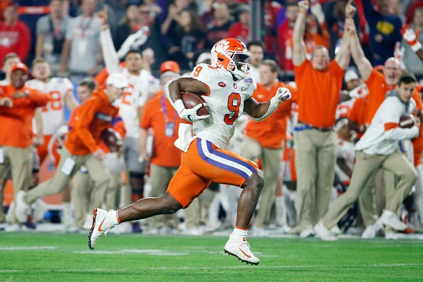 Clemson RB Travis Etienne rushes for a TD in the Fiesta Bowl.