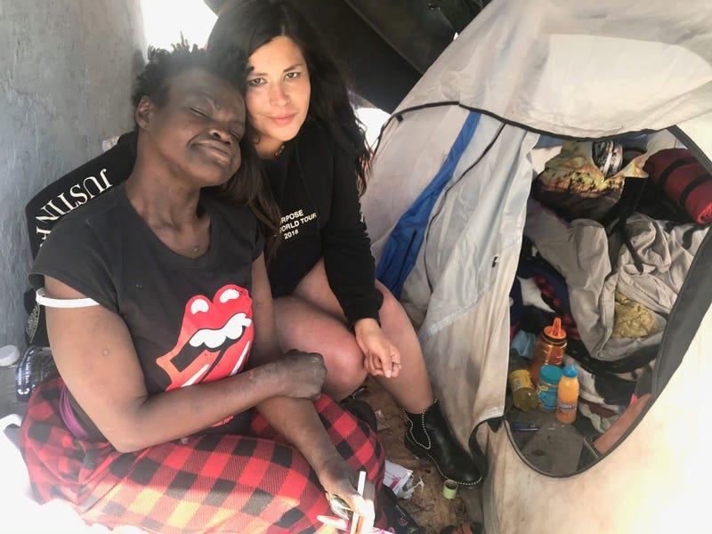 Sarah Zewdu and Liz Gutierrez in front of Gutierrez' tent, which is part of a homeless encampment in San Jose