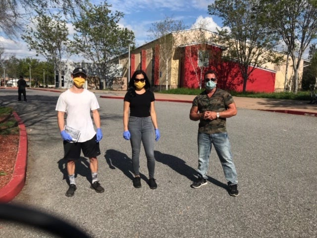 Taylor Marques, Vanessa Villareal, Pastor Scott Wagers in front of the Tully Community Branch Library in San Jose after completing homeless outreach trips