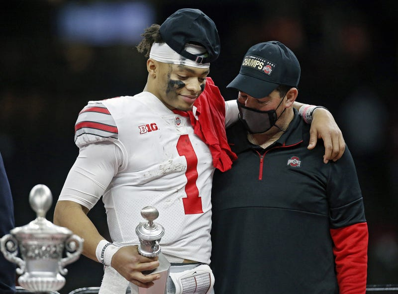 Ohio State Buckeyes head coach Ryan Day and quarterback Justin Fields share a moment after Fields was awarded the Most Outstanding Player award after beating Clemson Tigers 49-28 in the College Football Playoff semifinal at the Allstate Sugar Bowl in the Mercedes-Benz Superdome in New Orleans on Friday, Jan. 1, 2021.