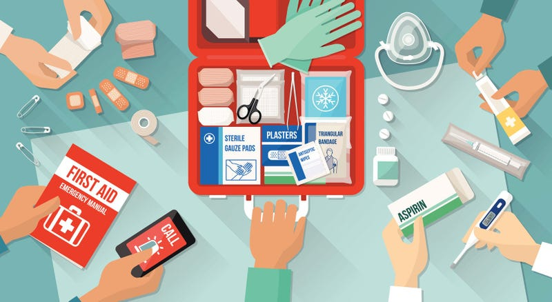 an illustration of several hands building a first aid kit