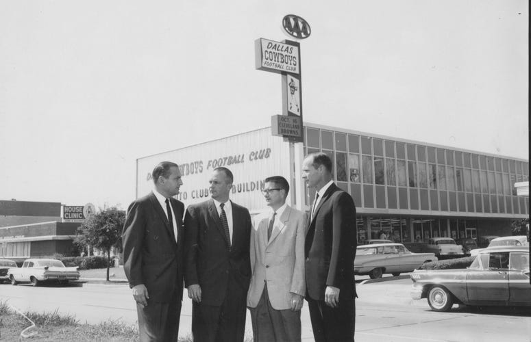 Tex Schramm, Bedford Wynne, Clint W. Murchison, Jr. and Tom Landry), pictured in front of the team's first administrative offices on North Central Expressway.