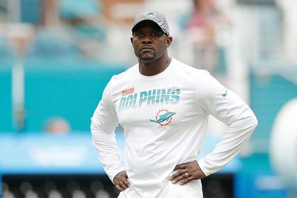 Brian Flores looks on before a Dolphins game.