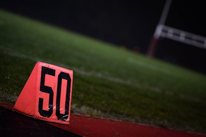 The 50-yard marker at a high school football field.