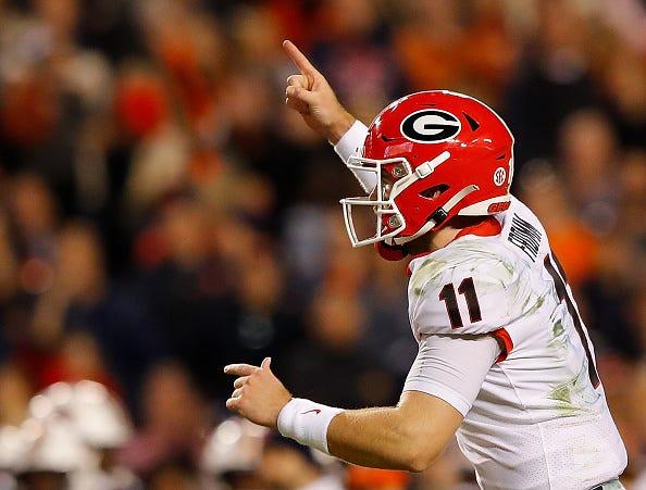 Jake Fromm celebrates a touchdown against Auburn.